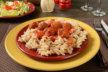 Meatballs and marinara sauce on gluten free pasta