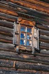 Window in the side wall of historic log cabin