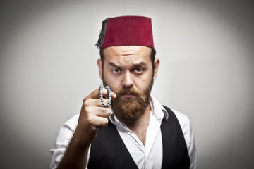 Man in traditional turkish hat and dress kabadayi