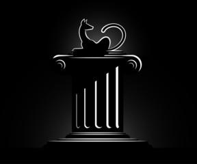 black cat on a column in light