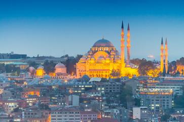 Mosque in Istanbul illuminated at dusk, aerial view
