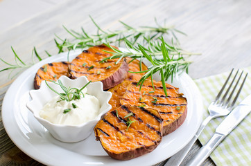 Healthy sweet potato baked and grilled with rosemary and sauce