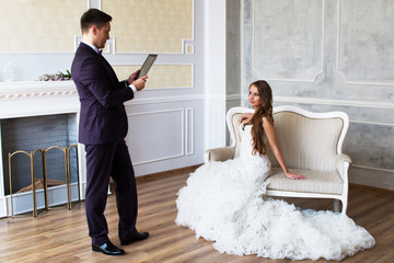 Beautiful couple is photographed on tablet computer
