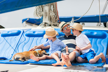 Family sailing on a luxury yacht
