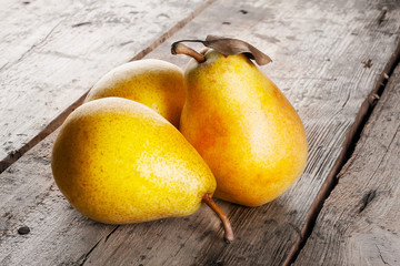 Three ripe juicy yellow pears