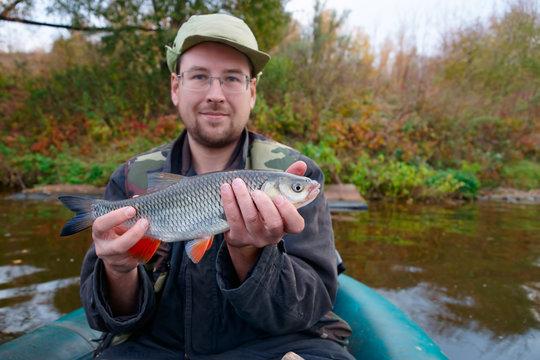 Fisherman with chub