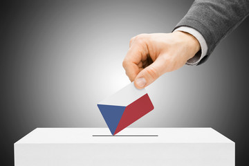 Male inserting flag into ballot box - Czech Republic
