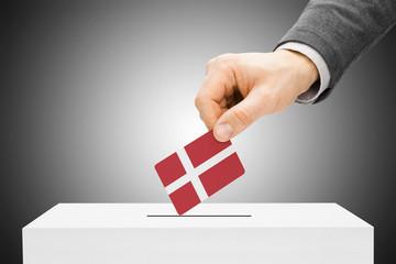 Voting concept - Male inserting flag into ballot box - Denmark