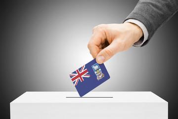 Male inserting flag into ballot box - Falkland Islands