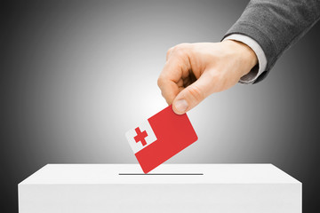 Voting concept - Male inserting flag into ballot box - Tonga