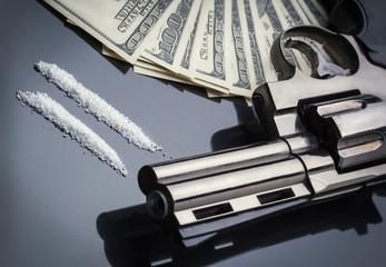 Gun, drugs and money concept