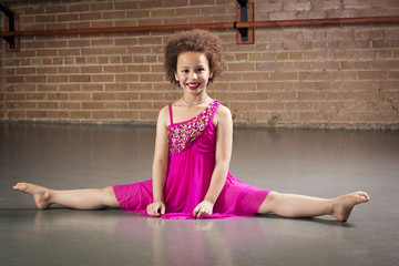 Gorgeous young ballerina at a dance studio