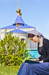 Woman reading an orthodox book