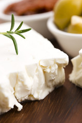 Feta cheese with olives, sun dried tomatoes and fresh herbs