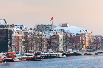 Amsterdam winter view with the river Amstel in front