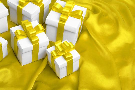 gift on yellow satin background