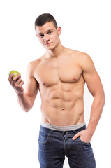 Fitness muscular man eat apple