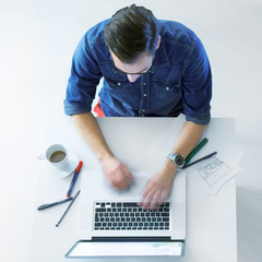 Casual Guy working on laptop