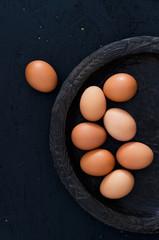 Multiple eggs on wooden plate