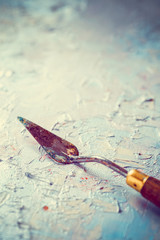 palette knife on artist canvas with oil paint