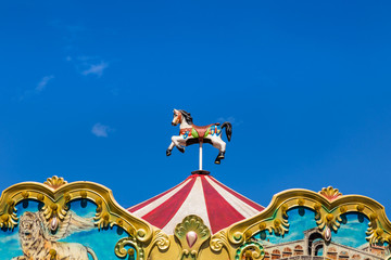 antique carousel horses tent in amusement park