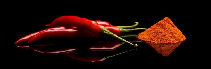 Studio shot chilli pepper, cayenne pepper isolated on black