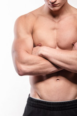Muscular man with crossed hands