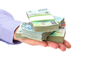 Cash in hand as a loan symbol over white background