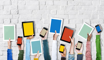 Group of Hands Holding Digital Devices