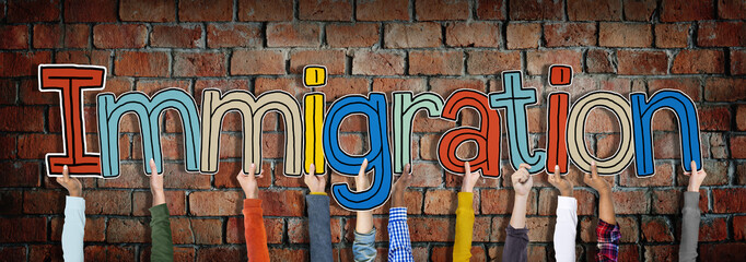 Hands Holding Immigration Word Concepts