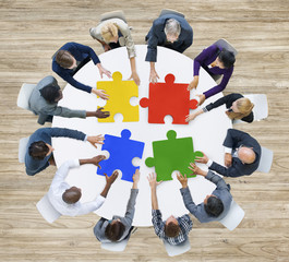 Business People with Puzzle Pieces and Teamwork Concept
