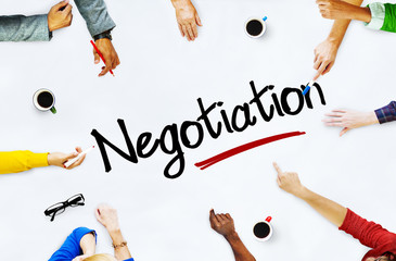 Multiethnic People Discussing About Negotiation