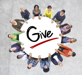 Group of People Holding Hands Around the Word Give
