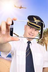 Pilot doing a Selfie on a hot beach