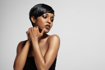 beauty black woman touching her face