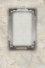 old picture frame silver isolated on marble background