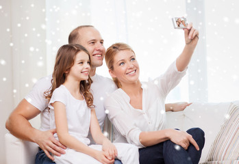 happy family with camera taking picture at home