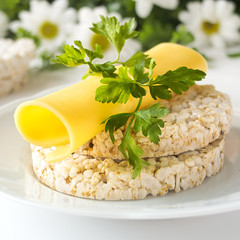 Rice cakes with cheese, parsley and chamomile