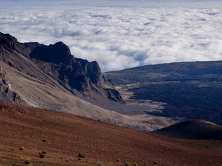 Haleakala volcanic crater with clouds drifting below