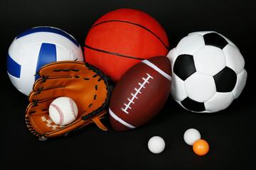 Sports balls on black background