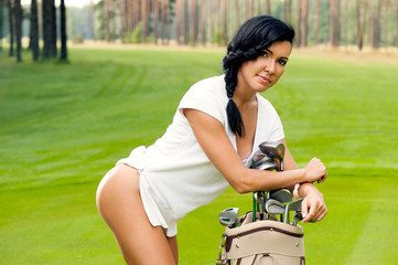 Attractive golfer girl on golf course