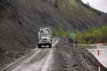 Truck at gravel road Kolyma highway outback Russia