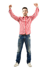 Excited man with clenched fist raise hands