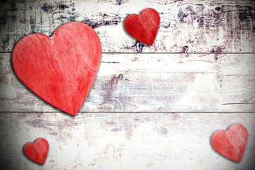 Wooden hearts on timbered background, space for text.