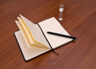 Notebook, diary, pen and timer. Deadline, writers block concept.