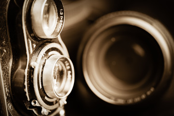 Vintage camera and lenses toned in sepia