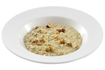 Bowl of oats porridge on a white background. Healthy breakfast