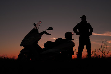 sunset and motorcyclists