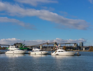 Recreational boats against industrial background
