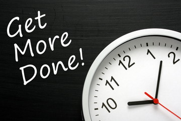 The phrase Get More Done on a blackboard with a clock